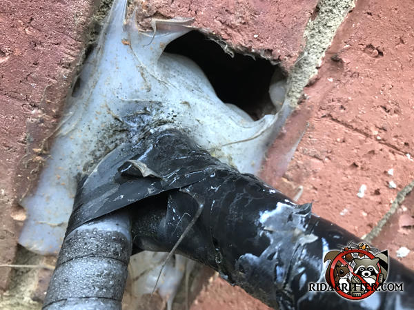 The handyman applied caulking around the hole where the air conditioning pipes pass through the brick wall, but it sagged before it set, leaving a hole