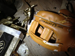 A baseball glove damaged by rat gnawing, next to a trophy, in an attic in Atlanta