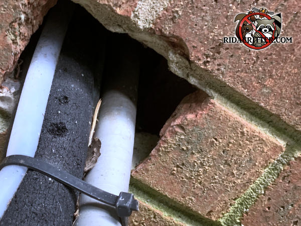 Rectangular gap in the bricks where air conditioning pipes pass through allowed rats into a house in Bremen Georgia