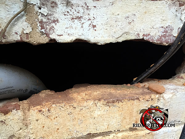 Missing brick with a conduit and a wire passing through the opening allowed rats into a house in Atlanta