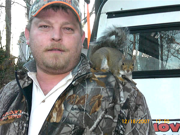Rid-A-Critter animal control supervisor Dean Scott with a squirrel on his shoulder