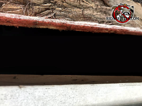 Two inch gap under the roof sheathing that allowed squirrels into the attic of a house in Alpharetta Georgia