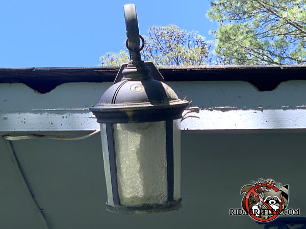 Two squirrel holes chewed through the top of the wooden fascia and into the attic of a house in Atlanta